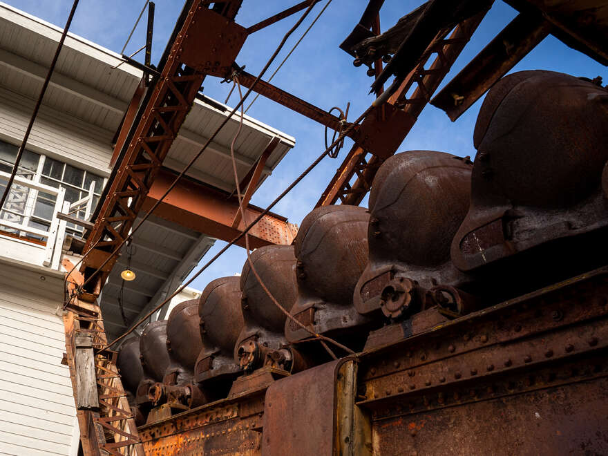 Looking up at the dredge's ore conveyer buckets.