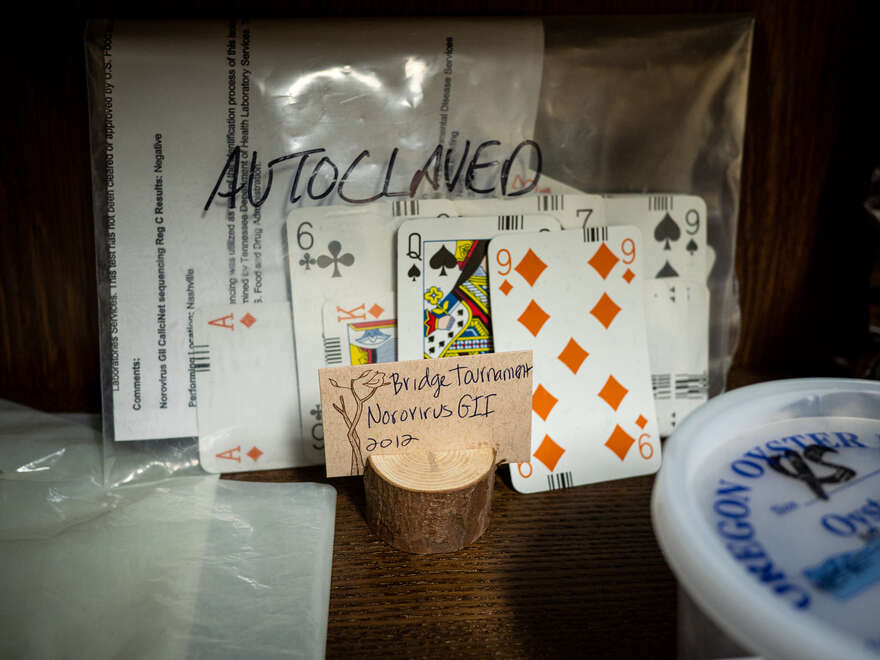 Playing cards from a bridge tournament at the center of a Norovirus outbreak.